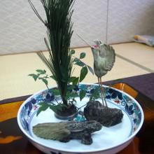 縁起物の鶴と亀の掻敷剥物